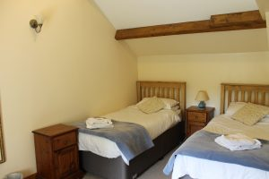 The first floor bedroom made up with twin beds.