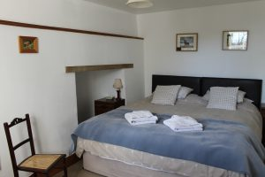 Large superking bed in ground floor bedroom, with cubby hole to the side.